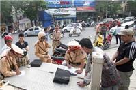 Đi xe máy không đội mũ bảo hiểm, bị xử phạt như thế nào?